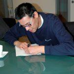 Secretaris Björn Bahlmann tekent Akte van Fusie